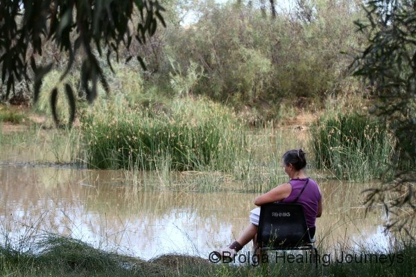 Nirbeeja relaxes beside Mungerannie wetlands. It was stinking hot while we were there.
