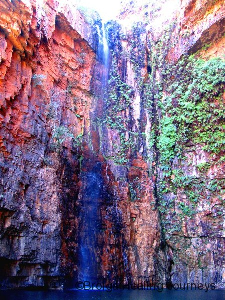 Waterfall at top of Emma Gorge.  You can just see the head of a swimmer at the base of the falls