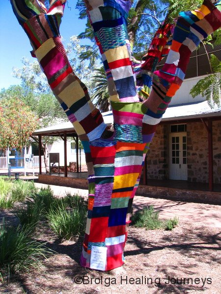 Part of the colour of the Annual Desert Festival in Alice Springs.  A tree-trunk in Todd Mall stays warm.