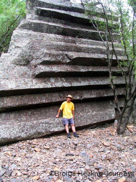 Peter beside nature's sculpture, a fallen chunk of Sawn Rocks