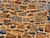 Rock art of a different kind.  Detail of wall, old general store, Cossack