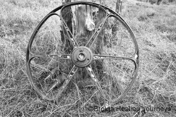 Old wheel near the ruins