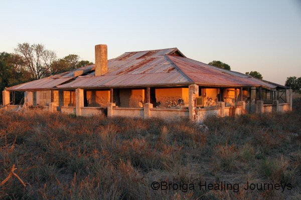 The old homestead aglow in the afternoon sun.  The building is now falling down, and off-limits.