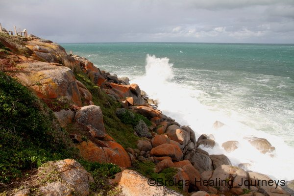 The wild Southern Ocean pounds the exposed side of Granite Island
