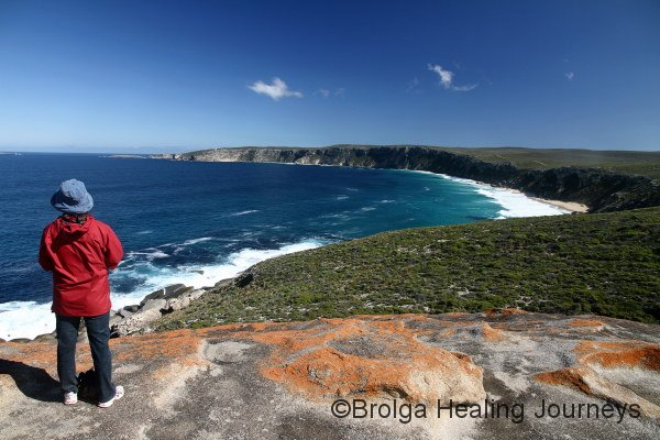 Nirbeeja takes in the splendour. View along the coastline west of Remarkable Rocks, Kangaroo Island.