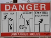Warning sign, Coober Pedy style!  Just love the one about walking backwards.