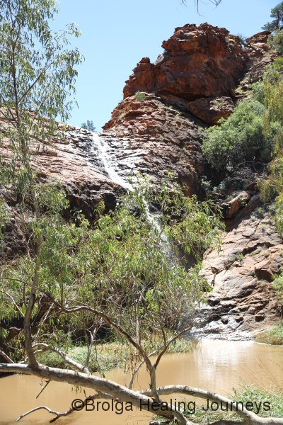 Waterfall into the sacred waterhole at Kathleen Springs