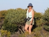 Nirbeeja walking through coastal heath to the point