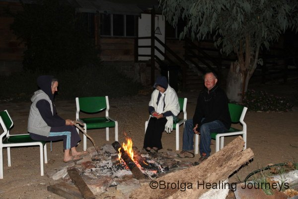 Happy campers!  Nirbeeja, Janice and Chris relaxing around the fire at Ross River Resort.