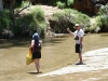 Nirbeeja and Chris (brandishing his high-tech trekking pole) contemplate crossing the water at Trephina Gorge