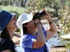 Two bird-watching sisters.  Nirbeeja and Bev (with binoculars) admire the wild Budgerigars