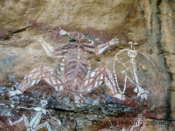 Nourlangie Rock, Kakadu National Park.  Powerful ochre figures.  Namarrgon - Lightning Man - to the right.