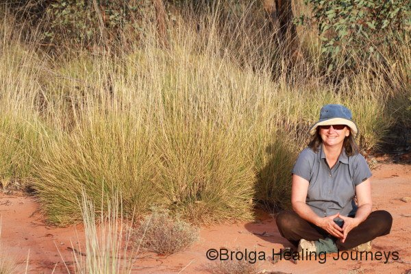 Nirbeeja takes a well-earned break beside some spinifex at the end of a long day.