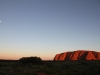 Uluru at sunset, moon rising.