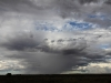 Storm clouds and rain on nearby country