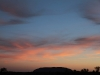 A pastel sunset over Uluru.  The whole sky was lit up.  See photos also on Kata Tjuta blog entry