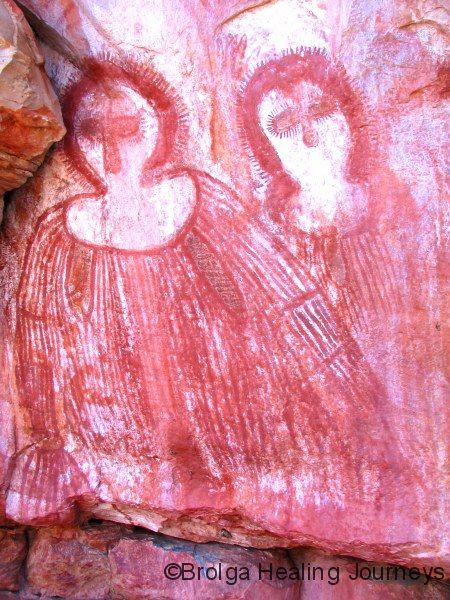 Powerful Wandjina images, Wunnumurru, the Kimberley. These figures are shown with torsos and arms, and striped clothing