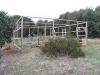 The vegetable garden enclosure under construction.  Builder Col far left, labourer/assistant Peter on right.