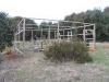 The vegetable garden enclosure under construction.  Builder Col far left, labourer/assistant Peter on right.